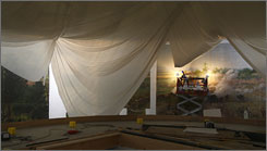 A conservator works on a section of the Battle of Gettysburg cyclorama painting in March.