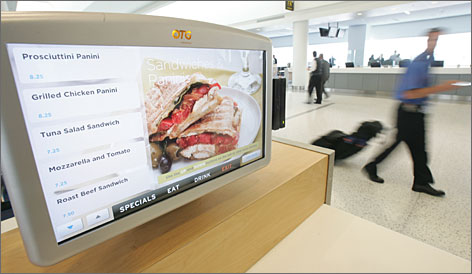 "Convenience on the menu: Terminal 5's ""re:vive"" food service concept features seating clusters with touch-screen monitors that promise to help keep travelers comfortable, fed and on time."