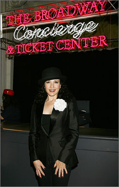 Actress Bebe Neuwirth poses at the Broadway Concierge & Ticket Center. The center offers ticket service for Broadway and off-Broadway shows as well as restaurant and hotel information.