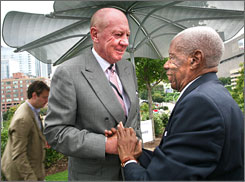 Coca-Cola Chairman Neville Isdell, left, greets civil rights activist Jesse Hill Jr. in downtown Atlanta at the site of the future Center for Civil and Human Rights. Coke donated the land to the museum.