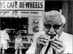 Colonel Sanders bites into a pie at Harry's in 1948.