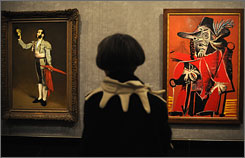 "An exhibit in Paris juxtaposes classic paintings with Picasso's interpretation of them. Shown is Edouard Manet's ""Matador Saluant"" (l) next to Picasso's  ""Mousquetaire a L'epee Assis."""