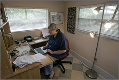 Current writer in residence Judy Copeland works in the office of the Kerouac home.