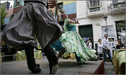 Dancers perform in the colorful La Boca neighborhood of Buenos Aires.