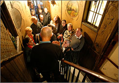 Steve Flicker leads a tour at the Tenement Museum, where immigrant families lived between 1863 and 1935.