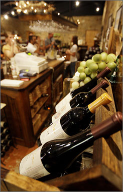 Bottles are displayed at the Torre di Pietra winery in Fredericksburg, Texas. There are 22 wineries in the Hill Country, seven around Fredericksburg alone, with two more slated to open soon.