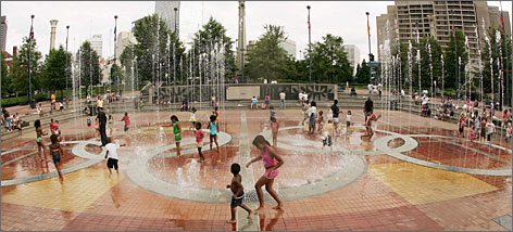 Water dances to music and lighting effects during a Fountain of Rings show at Atlanta's Centennial Olympic Park.