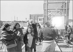 Director Donald Petrie stands with actresses Annabeth Gish, Julia Roberts and Lily Taylor at the Mystic River drawbridge during filming in 1987.