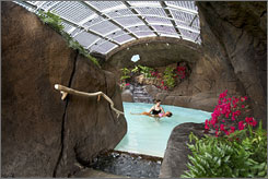 In Hawaii: Float with ease in the Watsu pool, inside a lava tube, at Mauna Lani Spa.