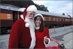 Santa and his helper get ready to greet passengers on the Great Smoky Mountains Railroad in Bryson City, N.C. Train rides themed on The Polar Express are offered in more than 20 states.