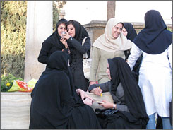 In accordance with the code: Iranian women at the Shiraz's Hafez tomb are conservatively covered from head to toe.