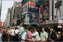 Customers line up at the TKTS tickets booth in New York's Times Square. Gift certificates for nearly 50 productions are available in $25, $50 and $100 denominations.