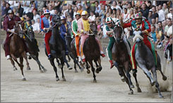 When in Siena ... See the Tuscan town's popular bareback horse race.
