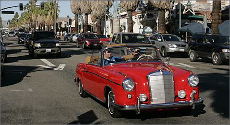 A classic car in a modernized setting: A 1960 Mercedes convertible cruises down Palm Canyon Drive in Palm Springs, the biggest of the Coachella Valley's nine cities.