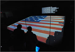 The Star-Spangled Banner has a new home in the renovated National Museum of American History. The dimly lit gallery is designed to reduce stress on the fragile fabric of the flag.