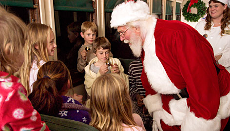 Williams, Ariz.: It's like The Polar Express as Santa boards the train with special gifts  and every child gets a sleigh bell.