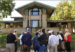 Tourists visit the Dana-Thomas House, perhaps the best-preserved example of famed architect Frank Lloyd Wright's Prairie period dwellings, in Springfield, Ill. The house is one of several parks and historic sites being closed due a $2 billion state budget deficit.