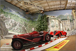 The cavernous facility showcases cars in huge dioramas, designed by Simeone himself.