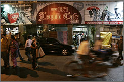 Popular spot: The Leopold Cafe in Mumbai - the scene of one of the first terrorist attacks last week - was back in business Monday as many shopkeepers reopened for the first time since the attacks.