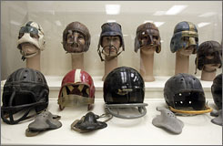 A display at the Sports Museum of Los Angeles shows the evolution of football helmets and nose guards.