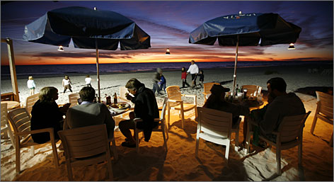 Island ritual: Watching the sun go down is an Anna Maria tradition. At The Sandbar, whoever guesses the minute the sun sinks wins Champagne.