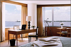 The Ritz-Carlton Battery Park attracts its share of celebrities and executives, but the vibe is low-key and the hip factor high with cool colors, pale woods, plush seating that begs you to dive in and contemporary art from New York artists. And the views are spectacular.