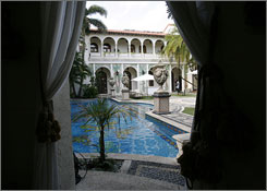 Casa Casuarina's pool - inspired by a Versace scarf and made of Italian mosaic tiles and 24-karat gold pieces - is a centerpiece of the tour.