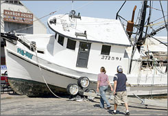Wendy and Richard Bedell of College Station, Texas, came to Galveston to see the damage caused by Hurricane Ike.