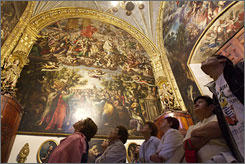 Tourists take in the painted walls of  the Metropolitan Cathedral, the oldest cathedral in the Americas.
