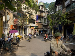 Forget the tour bus: Just hop on the back of a motorbike to see Hanoi, the capital of Vietnam, like Jerry Shriver did. The traffic rules  or lack thereof  may be a little scary, but the experience gives visitors a real taste of the city.