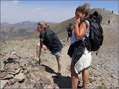 Throw caution to the wind: Kitty Bean Yancey joined Betsy Conway (left) and guide Sherry Malanify (right) on a gusty hike to Avalanche Peak on an adventure tour in the Grand Tetons. She biked off-road, climbed rocks, and faced a herd of buffalo.