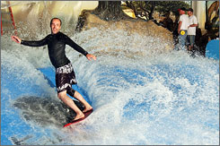In Wisconsin: Tom Kruger surfs at Kalahari Waterpark Resort, which has expanded its offerings.