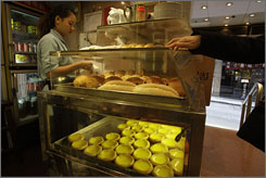 A woman sells egg tarts at a restaurant in Central. Street food is a way of life in Hong Kong.