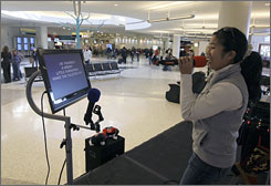Traveler Miyuki Chovantez takes the stage at Houston's George Bush Intercontinental Airport. This is the first year the airport has included karaoke among its array of seasonal musical entertainment.