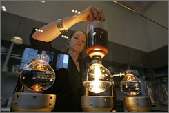 Holly Anderson stirs a pot of siphon coffee at the Blue Bottle Cafe in San Francisco, voted one of the top U.S. coffee bars by Food & Wine.