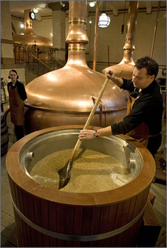"""An actor explains the brewing process while stirring a steaming cauldron full of """"wort"""" - the mash that is mixed with yeast before beer is fermented."""