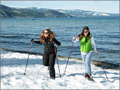 South Lake Tahoe, Nev.: Amanda Sereni, left, and Erin Sereni of Lafayette, Calif., get in some    snowshoeing along the shore. The Sierra Nevada's groomed trails offer miles of serenity - and a great workout.
