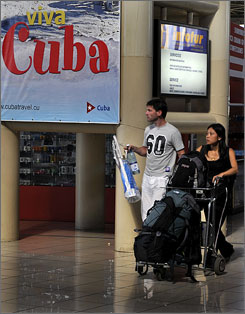 Tourists arrive at Jose Marti International Airport in Havana on November 14, 2008. Some 2.35 million foreigners visited the island last year.