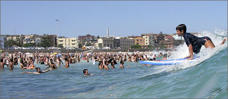 Tourists and locals enjoy a day at Sydney's Bondi Beach, one of the world's most famous beaches.