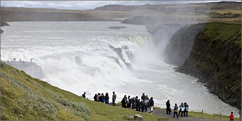 "Iceland's Gullfoss Waterfall: In English, it's ""Golden Falls."" In Iceland, it's one of most popular attractions. The clouds of mist create rainbow after rainbow."