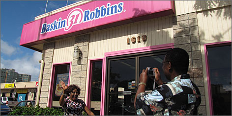 Milestones: Ben and Olive Nworie of Los Angeles check out a Baskin-Robbins store in the Makiki neighborhood where Obama worked during high school.