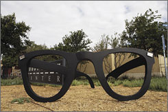 In Lubbock, Texas: The Buddy Holly Center features a sculpture of the singer's distinctive glasses.
