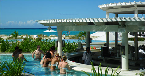 Relax during a recession: Guests at the Regent Palms can swim up to get drinks at the resort's poolside bar, as well as a fourth night free.