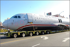 The wreckage of the Airbus A320 was plucked from a barge at a marina in Jersey City, placed on a trailer, and driven through the streets of New Jersey to a salvage yard.
