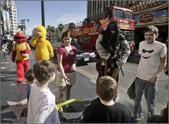 Captain Jack Sparrow and other famous characters greet tourists on Hollywood Boulevard.