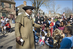 In Virginia: As part of Colonial Williamsburg's Nation Builders program, James Ingram talks to visitors as Gowan Pamphlet, a Baptist slave preacher, about blacks' experiences during the American Revolution.