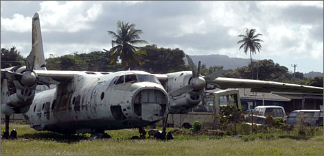 Rusted cargo planes from the 1983 U.S. invasion of Grenada sit at Pearls Airport.
