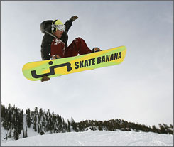Altitude with attitude: Snowboarder Dave Fleming gets some big air at Snowbird, one of four affordable resorts that are 25 miles east of Salt Lake City.