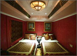 "The ""Lalgarh Palace"" suite of the new luxury train Royal Rajasthan on Wheels. The train has at times been left languishing in the rail yards as the global economic crisis and the aftermath of the Mumbai attacks put the brakes on India's tourist boom."