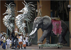 Visitors walk by sculptures at the Samba City in Rio de Janeiro.  While the percentage of foreigners in the Carnival crowds is expected to drop to 30% from about half, Rio's official tourism agency expects Brazilians to make up the difference.